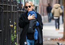 carey mulligan holding baby on street