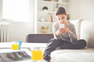 Boy playing on phone