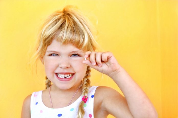 Child with tooth