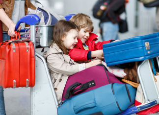Children travelling in airport