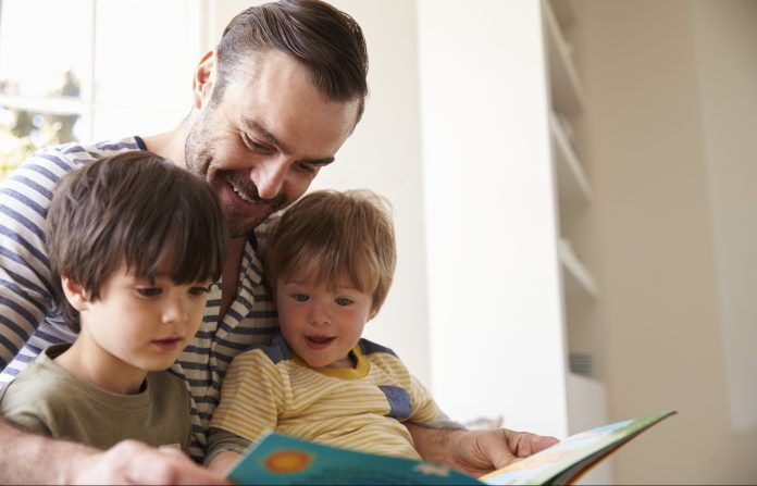 Dad reading to his children