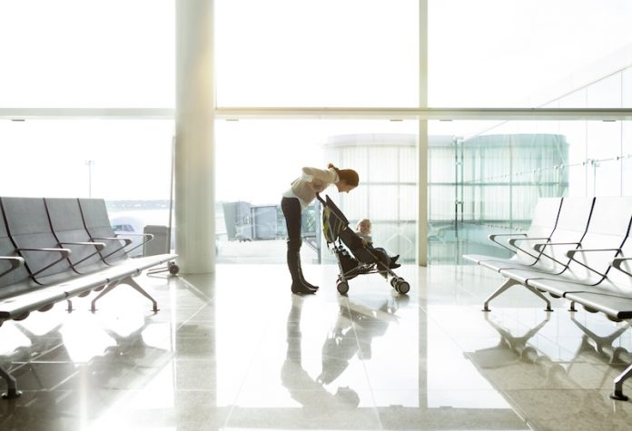 Mother and baby at the airport