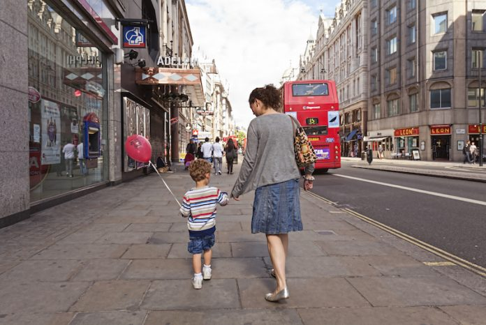 Mother and son walking in London
