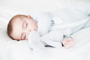 Baby sleeping in Mori sleepsuit