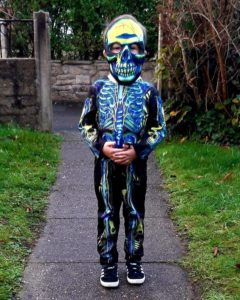Boy in skeleton costume
