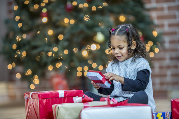 Child opening Christmas present