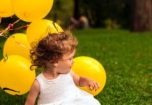unique-baby-names-girl-baby-yellow-baloons