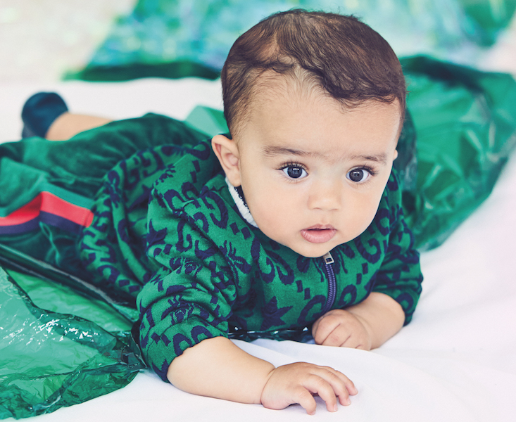 Baby in green outfit